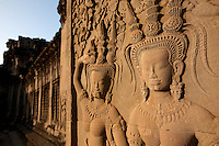 January 14th, 2009_SIEM REAP, CAMBODIA_ People enjoy a sunrise at Cambodia's number one tourist attraction, the Anchor Wat Temple.  Anchor Wat is a vast complex of temples and other significant structures and is a UNESCO World Heritage site.  Photographer: Daniel J. Groshong/Tayo Photo Group