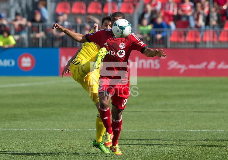 18 May 2013: Toronto FC midfielder Reggie Lambe #19 and Columbus Crew midfielder Matias Sanchez #8 in action during the first half in an MLS game between the Columbus Crew and Toronto FC at BMO Field in Toronto, Ontario Canada....