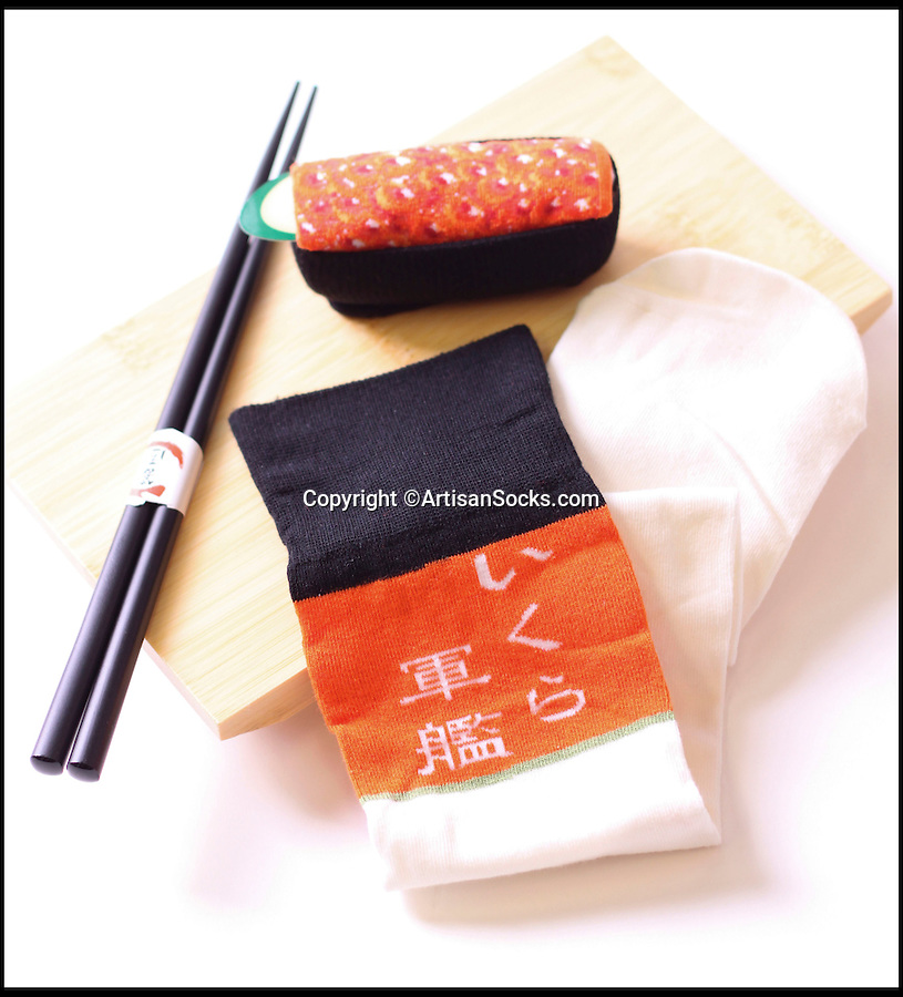 BNPS.co.uk (01202 558833)<br /> Pic: ArtisanSocks/BNPS<br /> <br /> ***Must Use Full Byline***<br /> <br /> Salmon roe sushi socks.<br /> <br /> Soft Sushi Shuffle...<br /> <br /> Salmon Roe sushi socks. <br /> <br /> Now, should you wish to, you can make your sock draw look like a sushi bar.<br /> <br /> These morsels of mouthwatering sushi might look tantalising but you wouldn't want to eat them - because they're actually rolled up socks.<br /> <br /> The super-realistic items of clothing are the latest bizarre trend sweeping the fashion world and have been an instant hit with shoppers.<br /> <br /> Unrolled they look like any other sock but rolled up they form seven different varieties of the raw fish snack, transforming your underwear drawer into a smorgasbord of sushi.<br /> <br /> The life-like 'flavours' include egg (tamago), salmon roe (ikura), shrimp (ebi), octopus (tako), tuna (maguro ), salmon (sa-mon) and trout (masuzishi).<br /> <br /> Sushi socks cost $6 a pair - around £3.70 - and can be bought from artisansocks.com.