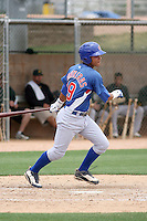 Willson Contreras #19 of the Chicago Cubs plays in an extended spring training game against the Oakland Athletics at the Athletics minor league complex on May 18, 2011  in Phoenix, Arizona. .Photo by:  Bill Mitchell/Four Seam Images.