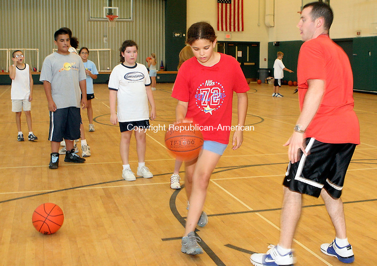 MIDDLEBURY, CT-26July 2006-072606TK09-  At the Memorial Middle School in Middlebury, Jack Baker, one of the instructors in the Middlebury Park and Recreation Department Basketball camp, oversees the efforts of Cara Meadows-Smith in a basketball dribbling exercise. Tom Kabelka Republican-American (Jack Baker)