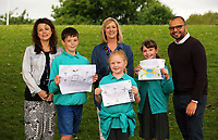 (L-R) Teacher Sarah-Lee Rees, first winner Cai Jones, 9, third winner Gwen Lindsey-Jones, assistant head teacher Karen Armstrong, second winner Caitlin Scotti 9 and Rav Raichura