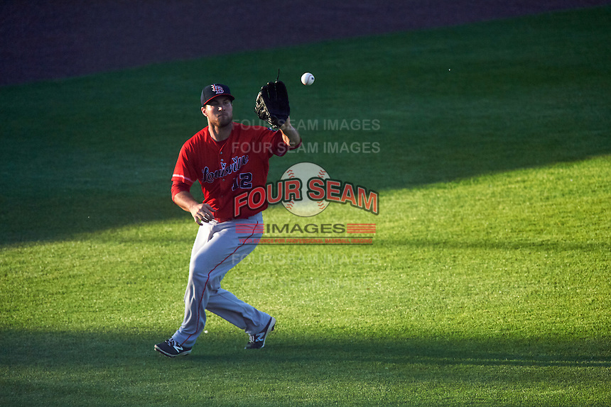 Louisville Bats left fielder Scott Schebler (12) catches a fly ball during a game against the Syracuse Chiefs on June 6, 2016 at NBT Bank Stadium in Syracuse, New York.  Syracuse defeated Louisville 3-1.  (Mike Janes/Four Seam Images)