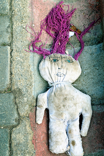 Child's lost doll on the streets of Athens, Greece