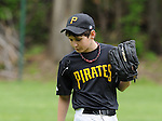 This young Lemont Pirate left fielder works on perfecting the art of spitting between pitches in a 2011 game in Lemont.