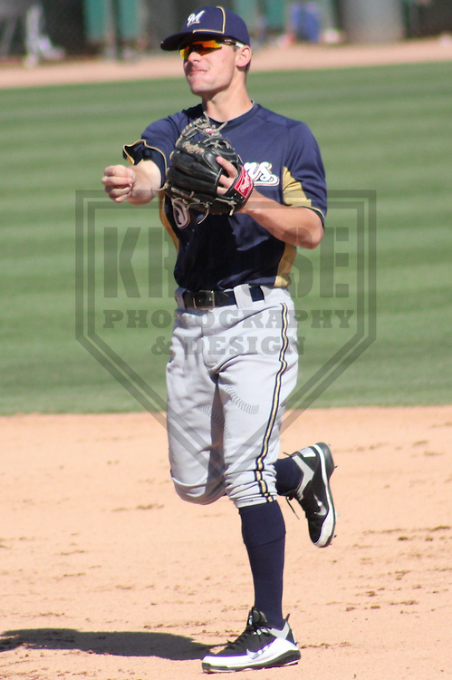 PHOENIX - March 2012: Scooter Gennett (15) of the Milwaukee Brewers during a Spring Training game against the Los Angeles Dodgers on March 20, 2012 at Camelback Ranch in Phoenix, Arizona. (Photo by Brad Krause).