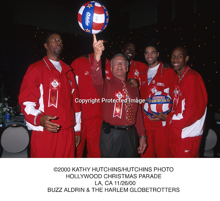 ©2000 KATHY HUTCHINS/HUTCHINS PHOTO.HOLLYWOOD CHRISTMAS PARADE.  LA, CA 11/26/00.BUZZ ALDRIN & THE HARLEM GLOBETROTTERS