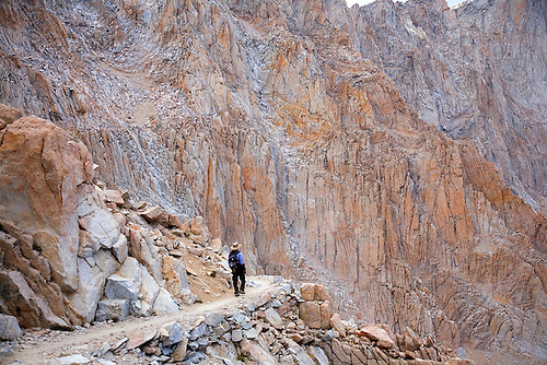 A SOLO HIKER MAKES THEIR WAY DOWN MT. WHITNEY ON THE MAIN MT. WHITNEY TRAIL IN SEQUOIA NATIONAL PARK, CALIFORNIA