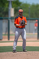 San Francisco Giants Orange relief pitcher Doug Still (60) checks the runner at first base during an Extended Spring Training game against the Oakland Athletics at the Lew Wolff Training Complex on May 29, 2018 in Mesa, Arizona. (Zachary Lucy/Four Seam Images)