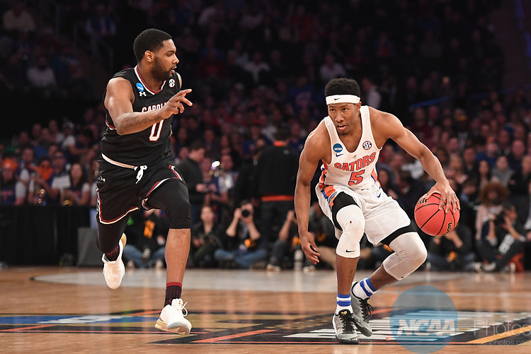 NEW YORK, NY - MARCH 26: KeVaughn Allen #5 of the Florida Gators is guarded by Sindarius Thornwell #0 of the South Carolina Gamecocks during the 2017 NCAA Men's Basketball Tournament held at Madison Square Garden on March 26, 2017 in New York City. (Photo by Justin Tafoya/NCAA Photos via Getty Images)