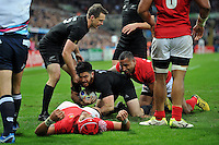 Nehe Milner-Skudder of New Zealand gets up after scoring a try. Rugby World Cup Pool C match between New Zealand and Tonga on October 9, 2015 at St James' Park in Newcastle, England. Photo by: Patrick Khachfe / Onside Images