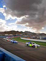 Nov. 9, 2008; Avondale, AZ, USA; NASCAR Sprint Cup Series driver Jimmie Johnson (48) leads a pack of cars during the Checker Auto Parts 500 at Phoenix International Raceway. Mandatory Credit: Mark J. Rebilas-