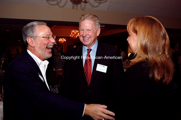 Watertown CT-20, November 2009-112009CM05--     Dr. Peter J. Jacoby, Chairman, Emergency Department of Saint Mary's Hospital (left) shares a laugh with George Giguere (center) and Mary Giguere of Woodbury. The United Way of Greater Waterbury held the 2009 Leavenworth Reception at the Watertown Country Club Friday night.  The event was held to thank the individual leadership givers who donated to the United Way.    Christopher Massa Republican-American