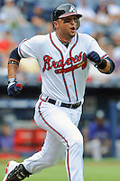 Atlanta Braves second baseman Martin Prado #14 runs to first during a game against the Colorado Rockies at Turner Field on September 3, 2012 in Atlanta, Georgia. The Braves  defeated the Rockies 6-1. (Tony Farlow/Four Seam Images).