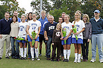 25 October 2009: Senior Day at Duke. Seniors Elisabeth Redmond (16), KayAnne Gummersall (13), Jane Alukonis (5), and Sara Murphy (11) pose with family and the coaching staff. The Duke University Blue Devils defeated the Virginia Tech Hokies 4-1 at Koskinen Stadium in Durham, North Carolina in an NCAA Division I Women's college soccer game.