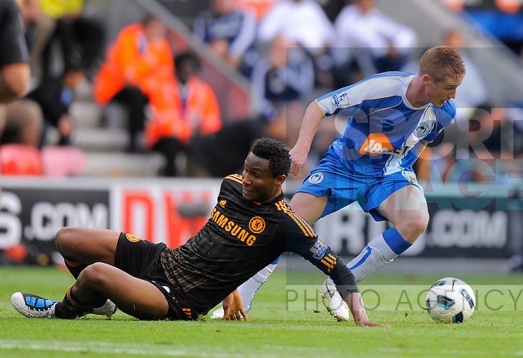 Jon Obi Mikel of Chelsea beaten by James McCarthy of Wigan Athletic