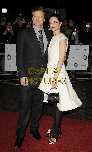 COLIN FIRTH & LIVIA GIUGGIOLI.London Critics' Circle Film Awards at BFI Southbank, London, England..February 10th 2011.ALFS full length black white suit sleeveless dress tights married husband wife handbag side.CAP/CAN.©Can Nguyen/Capital Pictures.
