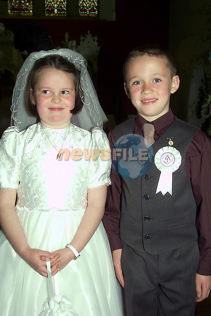 Niamh conway and John McKeown after making there first communion in Collon church.Picture Fran Caffrey Newsfile...This Picture is sent to you by:..Newsfile Ltd.The View, Millmount Abbey, Drogheda, Co Louth, Ireland..Tel: +353419871240.Fax: +353419871260.GSM: +353862500958.ISDN: +353419871010.email: pictures@newsfile.ie.www.newsfile.ie