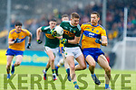 Gavin Crowley Kerry in action against Gary Brennan Clare during the Munster Senior Football Semi Final between Kerry and Clare at Ennis on Saturday night.