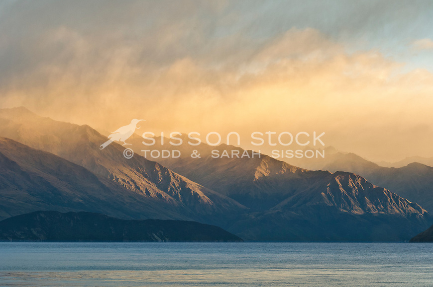 Close up of hazy sunlit  mountains and Lake Wanaka, South Island, New Zealand.