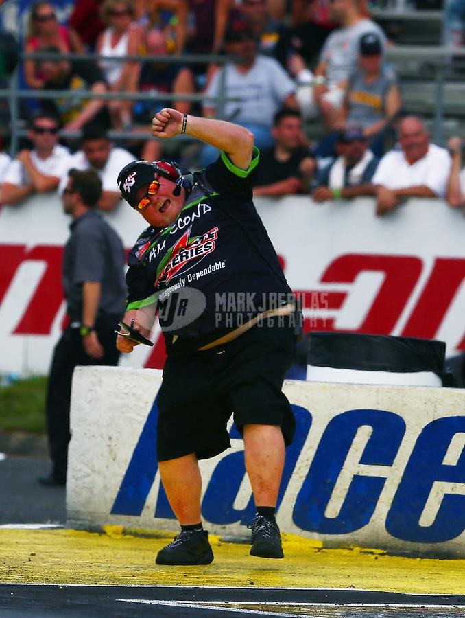 Jun. 2, 2013; Englishtown, NJ, USA: NHRA a crew member celebrates pro stock driver Mike Edwards during the Summer Nationals at Raceway Park. Mandatory Credit: Mark J. Rebilas-