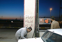 Near Mahmoudia, Central Iraq, Feb 9 2003..Gazoline price in Iraq is less than 1 cent (Euro or $) per liter..