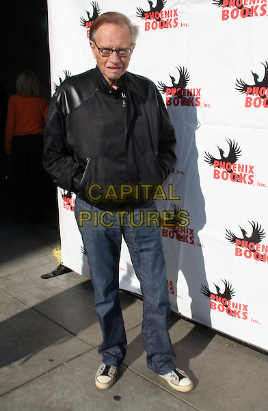 """LARRY KING.""""Super Bowl XLIII"""" Viewing Party held at Spago, Beverly Hills, California, USA..February 1st, 2009.full length black jacket hands in pockets glasses jeans denim .CAP/ADM/KB.©Kevan Brooks/AdMedia/Capital Pictures."""