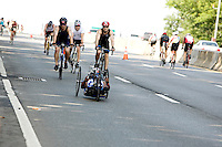 Minda competes in the biking leg of the Aquaphor New York City Triathlon via a handcycle in New York on July 8, 2012.