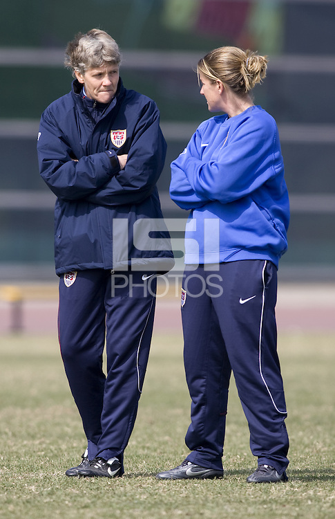 USA head coach Pia Sundhage talks with assistant coach Erica Walsh during practice in preparation for the Four Nations Tournament in Guangzhou, China on January 15, 2008