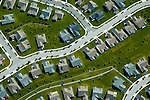 Aerial view of Aerial view, Housing Development,<br /> Monopoly Pieces,  stitching, earth, abstract, art Aerial views of artistic patterns in the earth.