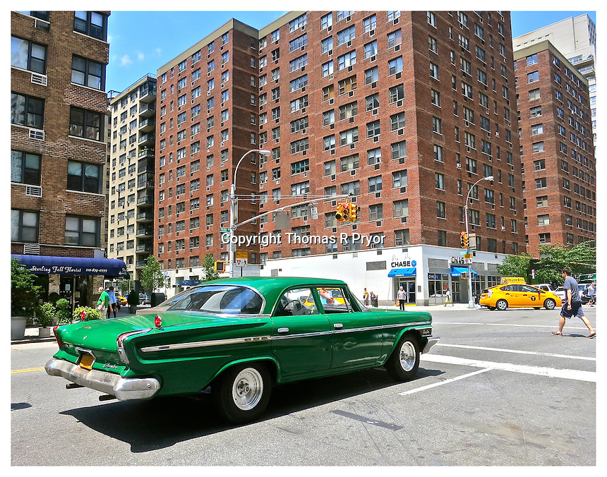 NEW YORK, NY- JULY 3: 1962 green Chrysler pictured on 79th street in Yorkville, New York on July 3, 2013. Photo Credit: Thomas R Pryor
