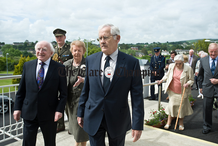 Kevin Norton, chairman of the Alzheimers Society of Ireland and Lillian Sullivan, Director of the Alzheimers Society of Ireland accompany President Michael D Higgins on his arrival to the official opening of the Watermans Lodge day Care and Respite centre at Ballina. Photograph by John Kelly.