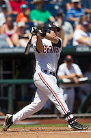 Oregon State third baseman Kavin Keyes (3) follows through on his swing against the Louisville Cardinals during Game 5 of the 2013 Men's College World Series on June 17, 2013 at TD Ameritrade Park in Omaha, Nebraska. The Beavers defeated Cardinals 11-4, eliminating Louisville from the tournament. (Andrew Woolley/Four Seam Images)