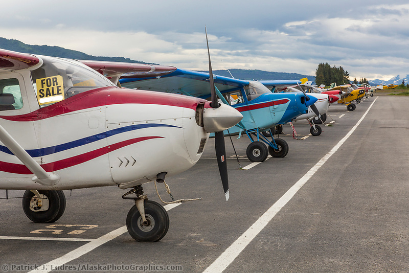 Small airplanes lined up on the tarmack in the coastal town of Homer, Alaska.