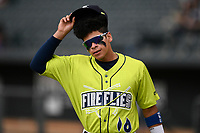 Shortstop Edgardo Fermin (10) of the Columbia Fireflies warms up before a game against the Greenville Drive on Friday, May 25, 2018, at Spirit Communications Park in Columbia, South Carolina. Columbia won, 3-1. (Tom Priddy/Four Seam Images)