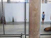 France. Department Ile-de-France. Paris. A japanese tourist visits the Palais de Tokyo. The Palais de Tokyo is a building dedicated to modern and contemporary art, located at 13 avenue du Président-Wilson in the 16th arrondissement of Paris. The western wing belongs to the French state and hosts since 2002, the Palais de Tokyo / Site de création contemporaine. 14.07.2011 © 2011 Didier Ruef *** Local Caption *** .