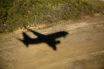 Aerial view of Commercial aircraft Shadow over land