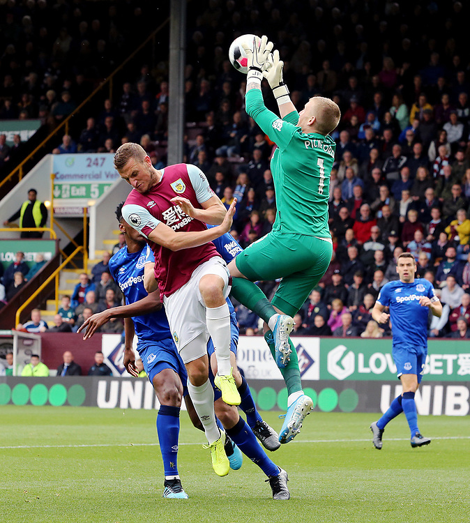 Everton's Jordan Pickford gathers under pressure from Burnley's Chris Wood<br /> <br /> Photographer Rich Linley/CameraSport<br /> <br /> The Premier League - Burnley v Everton - Saturday 5th October 2019 - Turf Moor - Burnley<br /> <br /> World Copyright © 2019 CameraSport. All rights reserved. 43 Linden Ave. Countesthorpe. Leicester. England. LE8 5PG - Tel: +44 (0) 116 277 4147 - admin@camerasport.com - www.camerasport.com