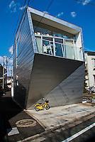 Ultra modern Tokyo residential home set against a blue sky.