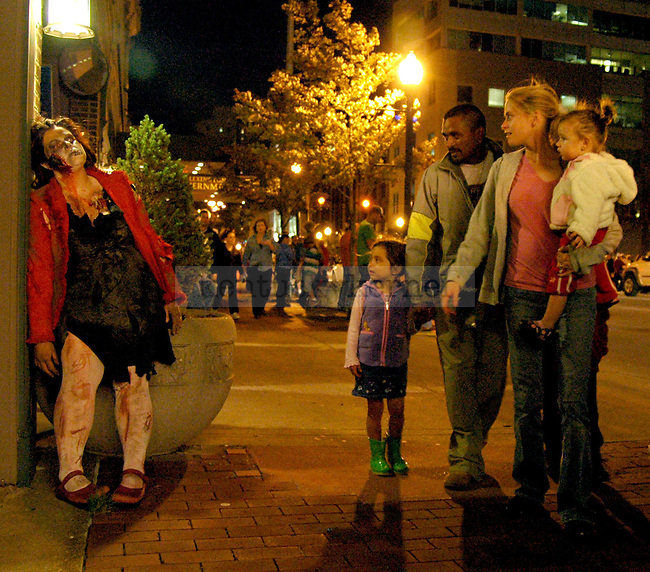 Tasha Rambacher acts as a zombie during the Thriller Parade in downtown Lexington Friday night. This was her second year as a zombie in the parade. .Photo by Jon Reynolds | Staff