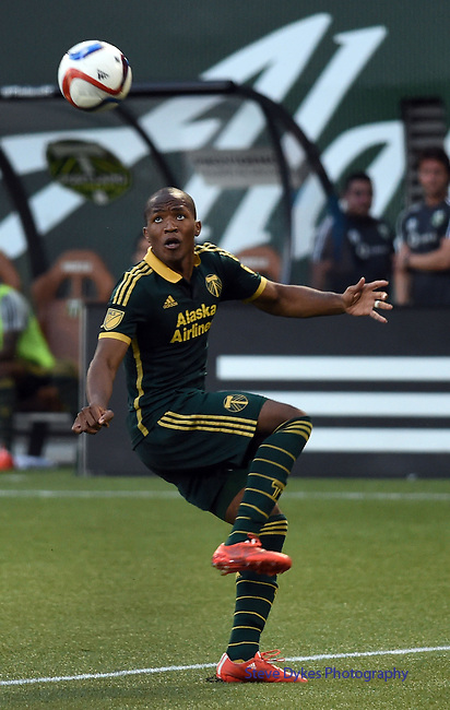 Jun 6, 2015; Portland, OR, USA; Portland Timbers forward/midfielder Darlington Nagbe (6) controls the ball during the second half of the game against the New England Revolution at Providence Park. The Timbers won the game 2-0. Mandatory Credit: Steve Dykes-USA TODAY Sports