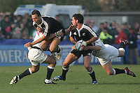 New Zealand fullback Isreal Dagg is tackled off the ball as Ryan Crotty moves play wide during the Division A U19 World Championship match at Ravenhill, Belfast.