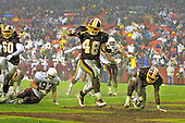 Washington Redskins running back Stephen Davis (48) scores the game-winning touchdown with a 2 yard run with 3:13 left in the fourth quarter against the Arizona Cardinals in Landover, Maryland on January 6, 2002.  The Redskins won the game 20 - 17.<br /> Credit: Arnie Sachs / CNP