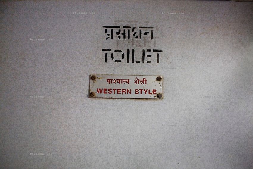 """""""Western Style"""" toilet sign on the Himsagar Express 6318 going from Jammu Tawi station to Kanyakumari on 7th July 2009.. .6318 / Himsagar Express, India's longest single train journey, spanning 3720 kms, going from the mountains (Hima) to the seas (Sagar), from Jammu and Kashmir state of the Indian Himalayas to Kanyakumari, which is the southern most tip of India...Photo by Suzanne Lee / for The National"""