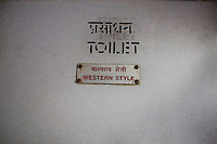 """Western Style"" toilet sign on the Himsagar Express 6318 going from Jammu Tawi station to Kanyakumari on 7th July 2009.. .6318 / Himsagar Express, India's longest single train journey, spanning 3720 kms, going from the mountains (Hima) to the seas (Sagar), from Jammu and Kashmir state of the Indian Himalayas to Kanyakumari, which is the southern most tip of India...Photo by Suzanne Lee / for The National"