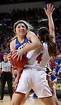 SIOUX FALLS, SD - MARCH 8:  Madison Guebert #11 from South Dakota State University takes the ball to the basket over Tia Hemiller #4 from the University of South Dakota in the 2016 Summit League Championship Game Tuesday afternoon in Sioux Falls. (Photo by Dave Eggen/Inertia)