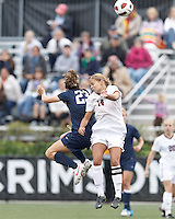 Yale University midfielder Shannon Conneely (23) and Harvard University midfielder/Defender Peyton Johnson (14) battle for head ball. In overtime, Harvard University defeated Yale University,1-0, at Soldiers Field Soccer Stadium, on September 29, 2012.