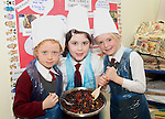 Tullyallen NS 1st Class students, Sarah Fox, Becky Clarke and Dannan Jackson making a Christmas Cake with their teacher Ms Clarke...(Photo credit should read Jenny Matthews www.newsfile.ie)....This Picture has been sent you under the condtions enclosed by:.Newsfile Ltd..The Studio,.Millmount Abbey,.Drogheda,.Co Meath..Ireland..Tel: +353(0)41-9871240.Fax: +353(0)41-9871260.GSM: +353(0)86-2500958.email: pictures@newsfile.ie.www.newsfile.ie.