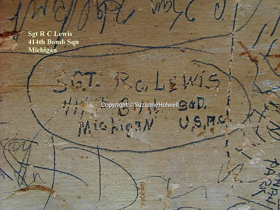 BNPS.co.uk (01202 558833)<br /> Pic: SuzanneHolwell/BNPS<br /> <br /> A signature by Sgt Lewis of 414 Bomb Sqn who flew on the historic first flight of American bombers over enemy territory. <br /> <br /> Sections of a torn-down pub ceiling which are covered in 250 signatures from World War Two heroes have been salvaged and turned into a memorial.<br /> <br /> The merry airmen left their mark during raucous evenings at the George and Dragon in the village of Clyst St George in Devon.<br /> <br /> Many of the brave men who signed or drew on the wood ceiling perished in the war in the skies with the Luftwaffe.<br /> <br /> One of them, Sergeant Albert Stilin, of 257 Squadron, was killed aged 21 when he crashed his Hurricane into this pub's roof on September 30, 1942. Another airman later put the initials 'RIP' put after his name.<br /> <br /> The ceiling was taken down in 1975 and half of it was destroyed. <br /> <br /> Robin and Suzannah Holwell recovered the surviving planks from a RAFA association store room in 2009 and have carried out a decade-long preservation project, putting the sections in frames and researching the men behind signatures.