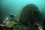Divers explore the wreck of the SS Tagona, Newquay, Cornwall, UK